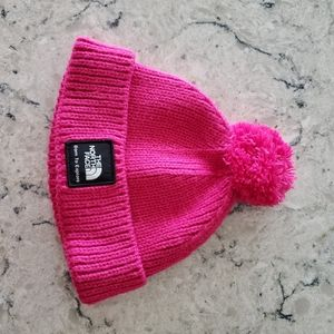 Infant pink North Face winter hat